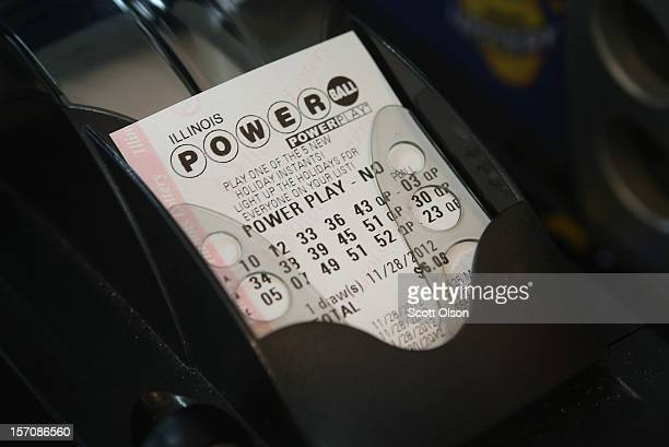 Powerball lottery ticket is printed for a customer at a 7Eleven store on November 28 2012 in Chicago Illinois Jim Bayci who owns the store estimates...