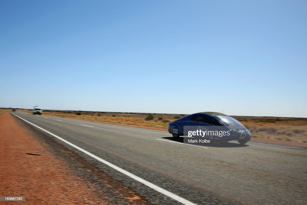 PowerCore SunCruiser from the University of Applied Sciences Bochum team, Germany races in the Clipsal and Schneider Electric Challenger Class on Day 4 on October 9, 2013 between Alice Springs and Kulgera, Australia. Over 25 teams from across the globe are competing in the 2013 World Solar Challenge - a 3000 km solar-powered vehicle race between Darwin and Adelaide. The race began on October 6th with the first car expected to cross the finish line on October 10th.