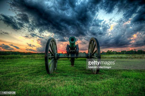 Powerful cannon with dramatic sky