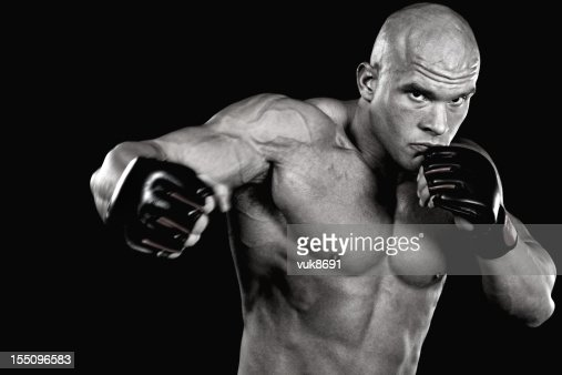 Powerful fighter punching : Stock Photo