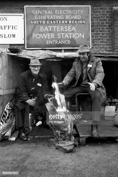 A powerful note from Battersea Power Station where two miners on picket duty in the absence of coal and coke warm their hands before a brazier of...