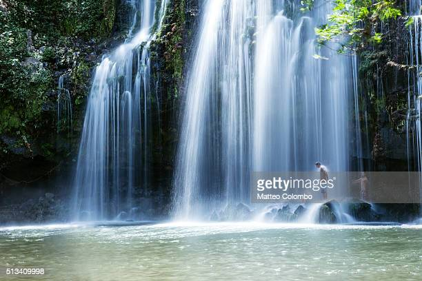 Powerful waterfall in the green forest of Costa Rica