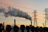 Powerlines stand near a petrochemical refinery smoke stack emitting water vapor in Houston Texas US on Monday Jan 3 2011 A federal appeals court...