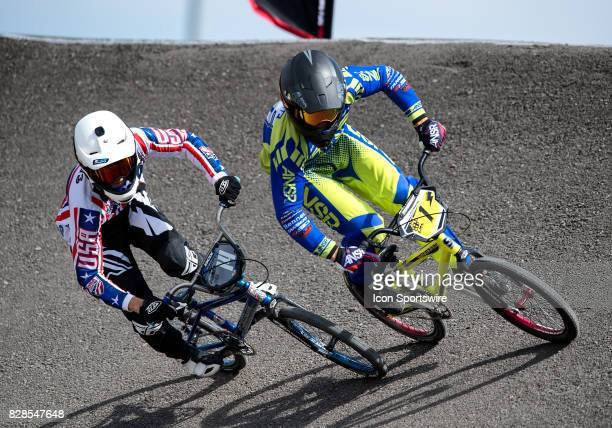 Powerlite's Ryan Marts and Answer/Ssquared's Matthew Meekins whip around turn one during 15 Expert action at the USA BMX Mile High Nationals on...