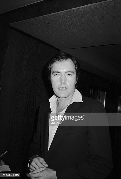 Powers Boothe wearing a suit jacket and open collar circa 1960 New York