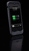 A PowerSkin Battery Case for iPhone 5 photographed on a black background taken on April 3 2013