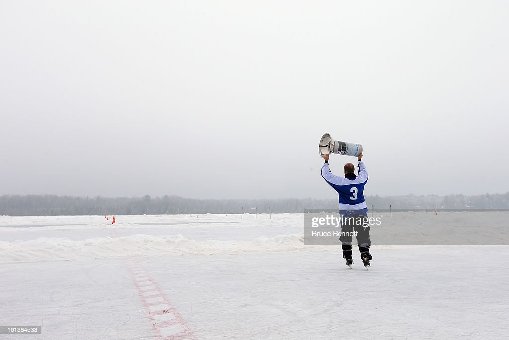 A Powervar player celebrates victory in the 2013 USA Hockey Pond Hockey National Championships on February 10, 2013 in Eagle River, Wisconsin. The three day tournament features 2,400 participants from 30 states playing a round robin tournament on 28 rinks laid out on Dollar Lake.