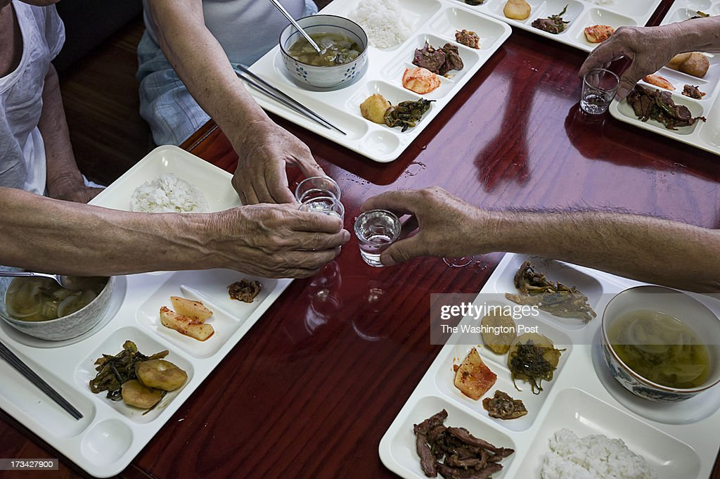 POWs escaped from North Korea make toasts during lunch at a care house on July 10, 2013 in Seoul, South Korea.