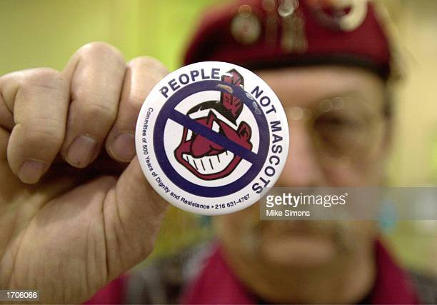 Powwow attendee Sonny Hensley holds an antimascot button to protest using Indians as mascots for sports teams at the 10th Annual New Years Eve...