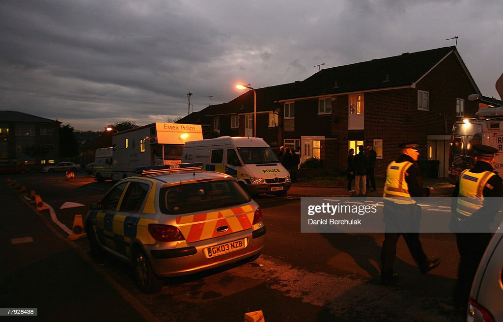 Ppolice patrol a street as vans are seen parked outside of a house in Margate where police continue their investigations on November 15 2007 in...