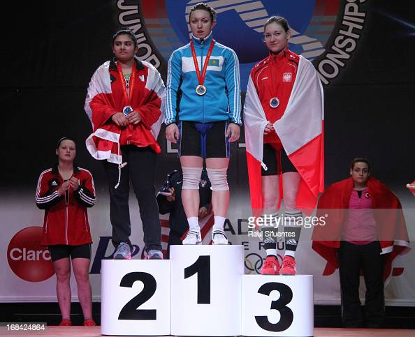 Prabdeep Sanghera of Canada A Anastsiya Shvabauer of Kazakhstan and Jolanta Wior of Poland A in the podium of Women's 75kg snatch during day six of...