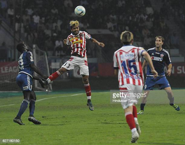 Prabir Das of ATK Kolkata is trying to clear a ball during the ISL match against Fc Pune City at Rabindra Sarobar stadium on December 2 2016 in...