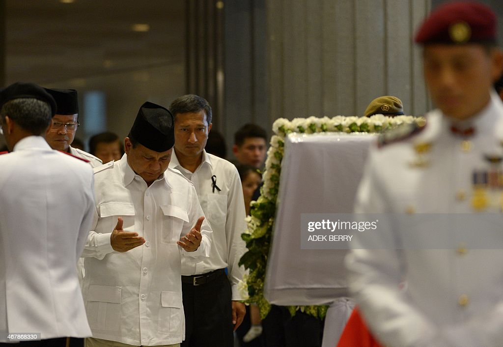 <a gi-track='captionPersonalityLinkClicked' href=/galleries/search?phrase=Prabowo+Subianto&family=editorial&specificpeople=3051840 ng-click='$event.stopPropagation()'>Prabowo Subianto</a> of Indonesia's Gerindra party prays while paying his respects to Singapore's late former pime minister Lee Kuan Yew where he lies in state at Parliament House in Singapore on March 28, 2015. Singapore's first prime minister Lee Kuan Yew, one of the towering figures of post-colonial Asian politics, died at the age of 91 on March 23.