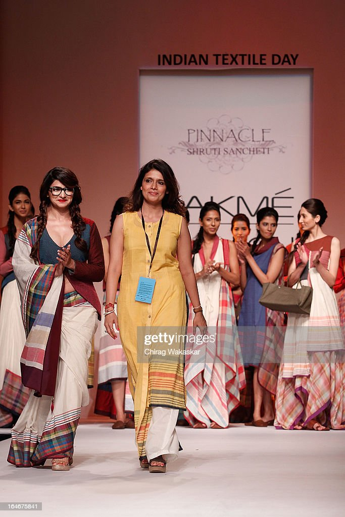 <a gi-track='captionPersonalityLinkClicked' href=/galleries/search?phrase=Prachi+Desai&family=editorial&specificpeople=5428962 ng-click='$event.stopPropagation()'>Prachi Desai</a> (L) & Shruti Sancheti (R) on the runway during day four of Lakme Fashion Week Summer/Resort 2013 on March 25, 2013 at Grand Hyatt in Mumbai, India.
