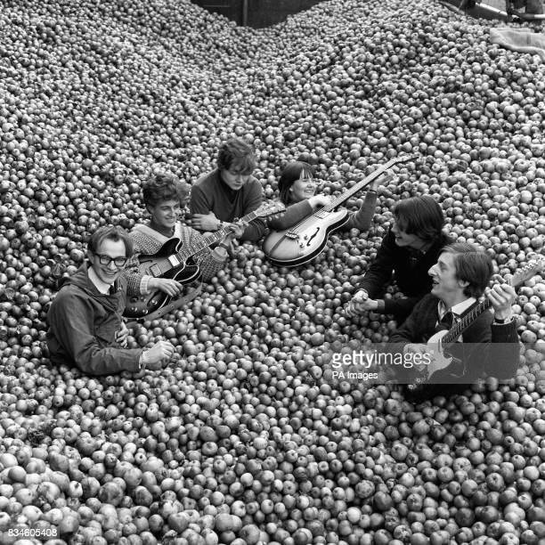 Practically submerged in fruit 'The Applejacks' one of Britain's top pop groups manage to maintain the beat during a visit to the world's largest...