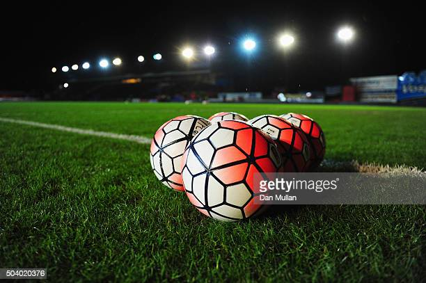 Practice balls it on the turf prior to the Emirates FA Cup third round match between Exeter City and Liverpool at St James Park on January 8 2016 in...