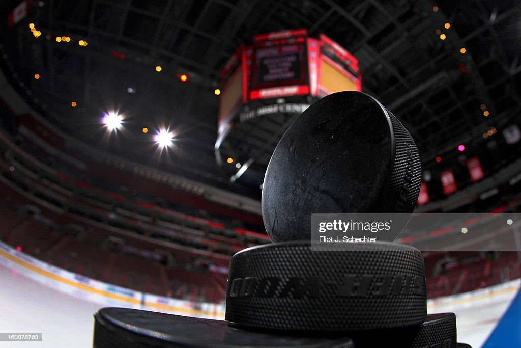Practice pucks at the ready prior to the start of the game between the Florida Panthers and the Winnipeg Jets at the BB&T Center on January 31, 2013 in Sunrise, Florida.