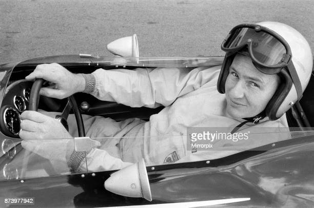 Practice session for the 1963 British Grand Prix Formula One race at Silverstone Northamptonshire Bruce McLaren ready to go as he leaves the paddock...