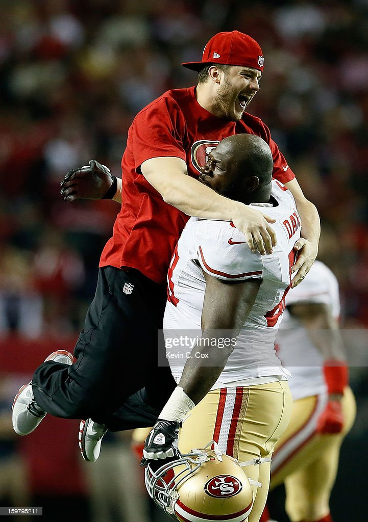 Practice squad player Nate Stupar and guard Leonard Davis #68 of the San Francisco 49ers celebrate after the 49ers defesnse stops the Atlanta Falcons on fourth down in the fourth quarter in the NFC Championship game at the Georgia Dome on January 20, 2013 in Atlanta, Georgia.