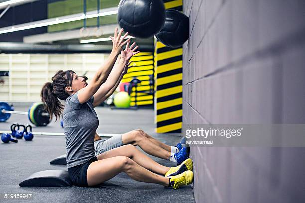 Practising with the medicine balls on the wall