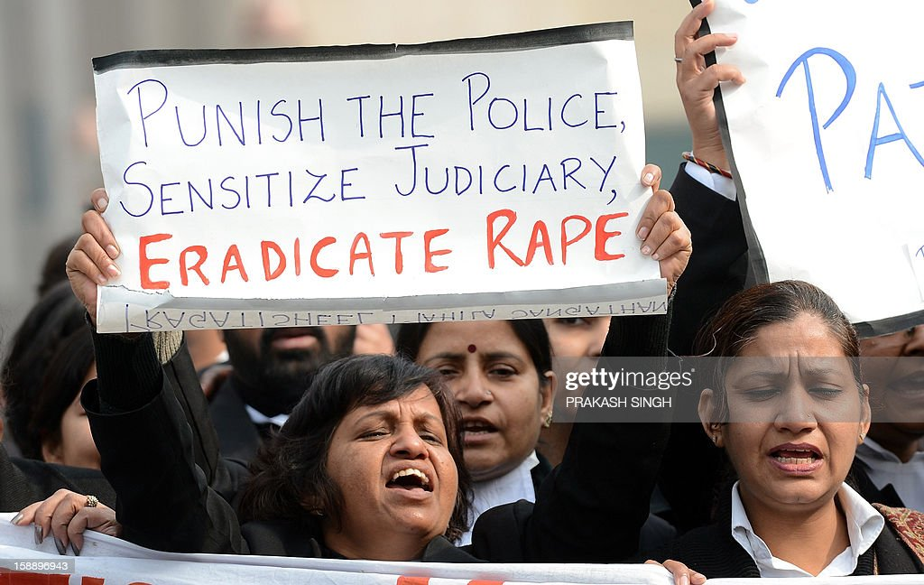 Pragatisheel Mahila Sangathan activists hold placards as they shout slogans during a protest at Saket District Court in New Delhi on January 3, 2013. A gang of men accused of repeatedly raping a 23-year-old student on a moving bus in New Delhi in a deadly crime that repulsed the nation are to appear in court for the first time. Police are to formally charge five suspects with rape, kidnapping and murder after the woman died at the weekend from the horrific injuries inflicted on her during an ordeal that has galvanised disgust over rising sex crimes in India. AFP PHOTO/ Prakash SINGH