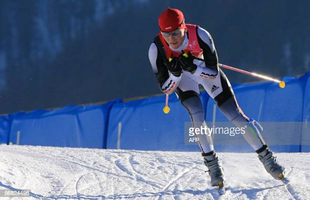 Germany's Georg Hettich competes in the Individual Gundersen 15 km during the 2006 Winter Olympic Games' Nordic Combined in Pragelato 11 February...