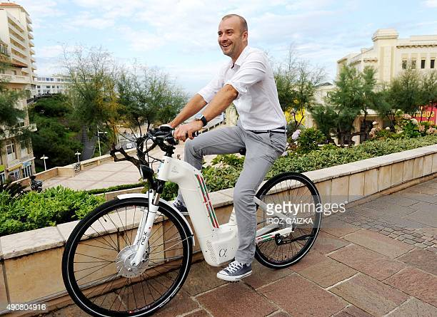 Pragma Industries's CEO Pierre Forte rides an Alpha electric bike that operates with the use of hydrogen on Septembe 30 2015 in Biarritz southwestern...