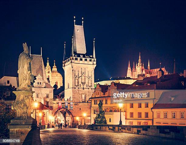 Prague at night with Charles Bridge, Hradcany and cathedral.