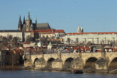 Prague Castle looms over Lesser Town district Charles Bridge and the Moldau River on December 19 2011 in Prague Czech Republic Prague is among...