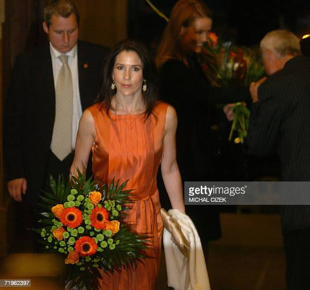 Denmark's Australianborn royal Crown Princess Mary walks to the performance of the Danish National Symphony 21 September in Rudolfinum concert hall...