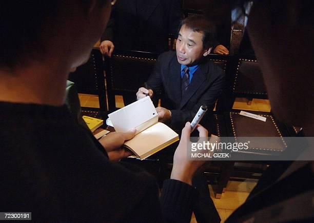 Japanese writer Haruki Murakami signs autographs 30 October 2006 in Prague after receiving the Franz Kafka Award for 2006 Murakami has been inspired...