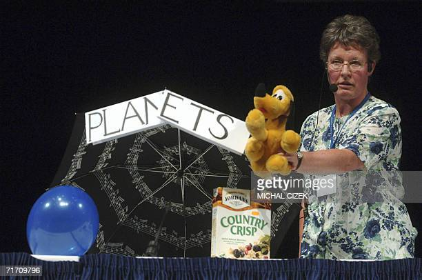 Jocelyne BellBurnell astronomer from Cambridge University displays a stuffed toy representing planet Pluto during the vote on Resolution on Planet...