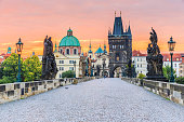 Prague, Czech Republic. Charles Bridge (Karluv Most) and Old Town Tower at sunrise.