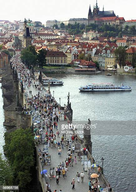 TO GO WITH AFP STORY FILES Picture taken 19 August 2005 shows tourists crowding Prague's landmark Charles Bridge The famous bridge will be kept open...