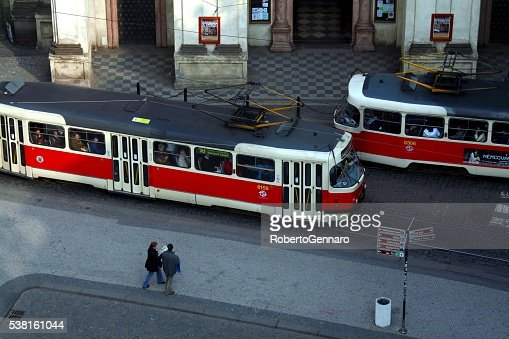 Prague Czech Republic tourist walking High angle Tram Cars