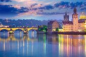 Famous Prague Landmarks at night time with city illuminated and beautiful sundown sky, Czech, Europe