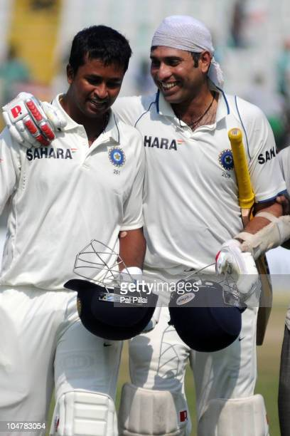 Pragyan Ojha and VVS Laxman of India celebrate India winning their first test on day five of the First Test match between India and Australia at...