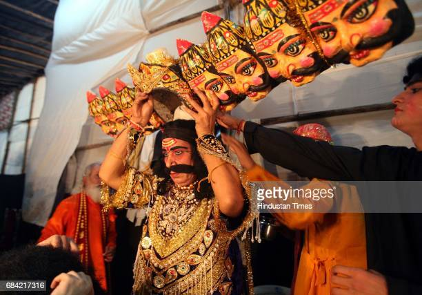 Prahlaad Chaturvedi who plays the character of Ravan poses for a photographer before making an entry on stage at Shivaji Park's Ramlila on Sunday