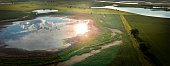 Aerial shot of a South Dakota Prairie Pot-hole or slough / pond...
