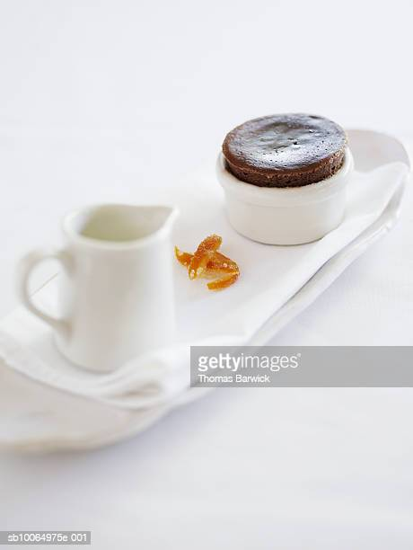 Pralus chocolate souffle with vanilla crema and candied orange, close-up