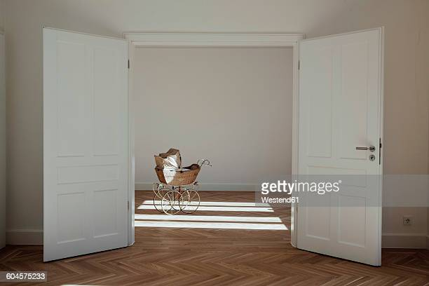 Pram in empty room, open doors