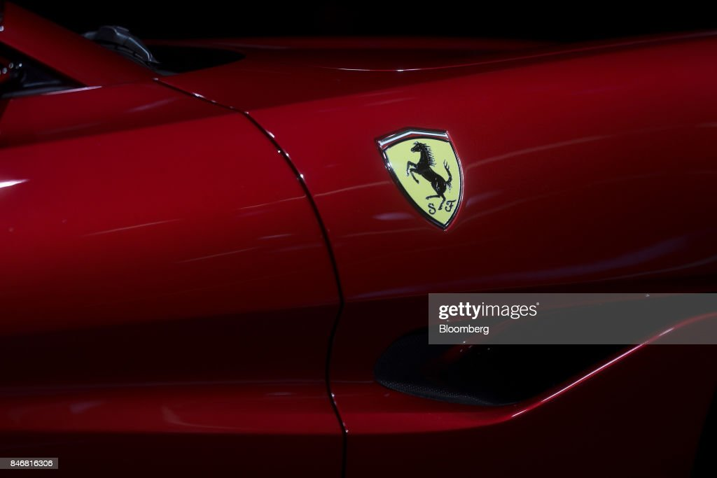 A 'Prancing Horse' badge sits on a Ferrari NV Portofino entry-level supercar during the second media preview day of the IAA Frankfurt Motor Show in Frankfurt, Germany, on Wednesday, Sept. 13, 2017. The 67th IAA opens to the public on Sept. 14 and features must-have vehicles and motoring technology from over 1,000 exhibitors in a space equivalent to 33 soccer fields. Photographer: Simon Dawson/Bloomberg via Getty Images