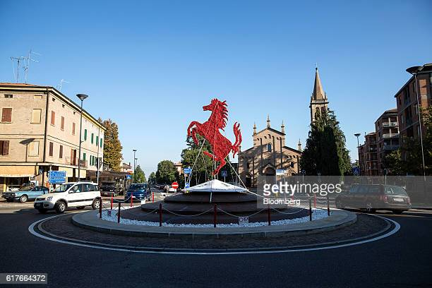 A prancing horse figure used in the Ferrari SpA logo stands in the centre of a road traffic roundabout in Maranello Italy on Tuesday Oct 4 2016 After...