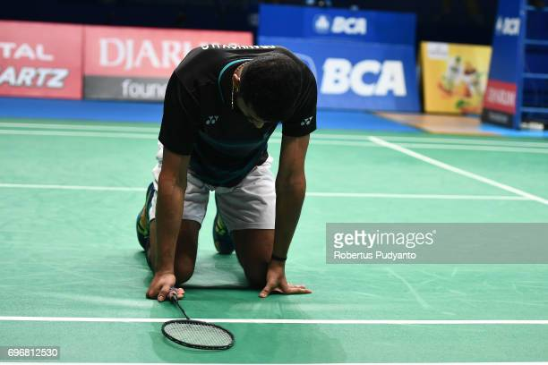 Prannoy H S of India falls during the game against Kazumasa Sakai of Japan in the Mens Single Semifinal match of the BCA Indonesia Open 2017 at...