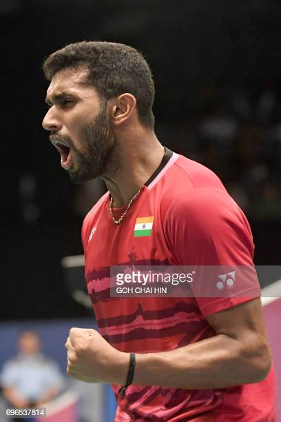 Prannoy HS of India reacts after winning a point against Zhen Long of China during their men's singles quarterfinal match at the Indonesia Open...