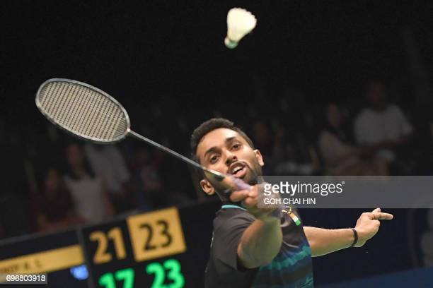Prannoy HS of India returns a shot against Kazumasa Sakai of Japan during their men's singles semifinal match at the Indonesia Open badminton...