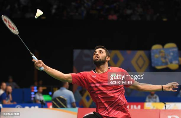 Prannoy HS of India returns a shot against Zhen Long of China during their men's singles quarterfinal match at the Indonesia Open badminton...