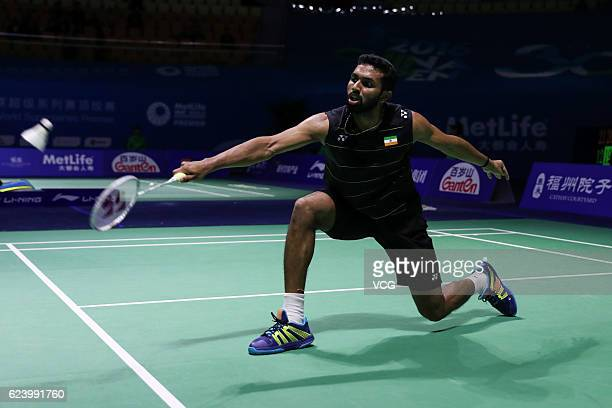 Prannoy HS of India returns to Qiao Bin of China during men's singles second round match on day three of BWF Thaihot China Open 2016 at Haixia...