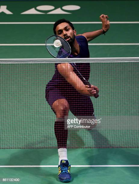 HS Prannoy of India hits a return towards Shi Yuqi of China during the men's singles quarterfinal match at the Japan Open Badminton Championships in...