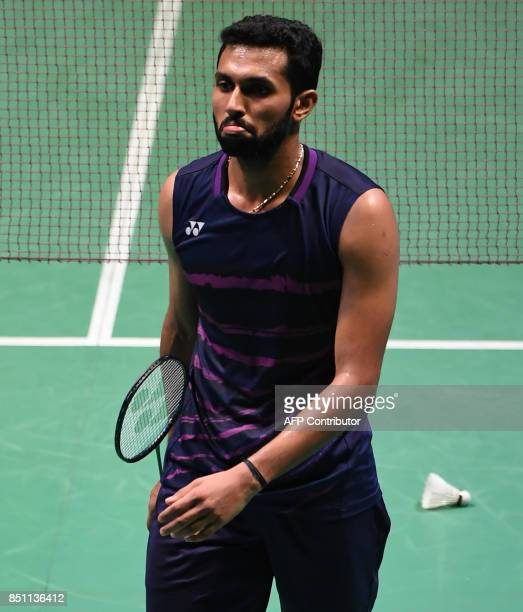 HS Prannoy of India shows his flastration during the men's singles quarterfinal match against Shi Yuqi of China at the Japan Open Badminton...